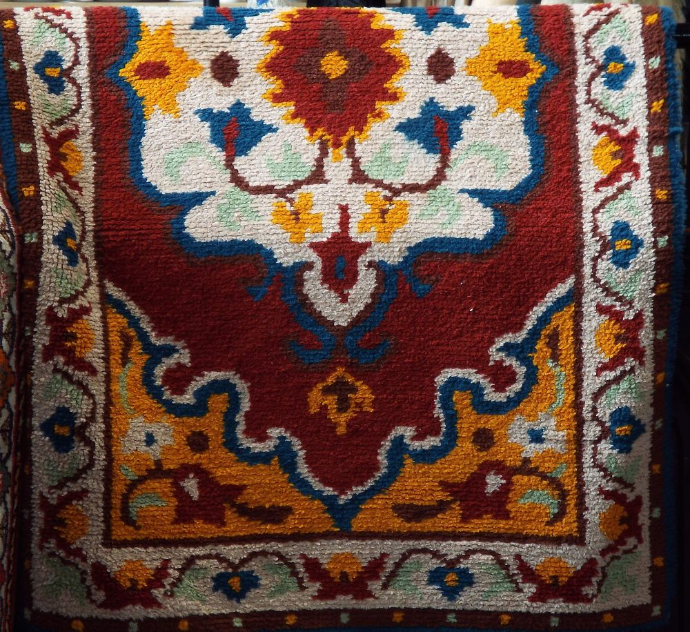 Lot 624 - Mid 20th century shag pile rug decorated with a unicorn under a tree on a black ground, 200 x 110