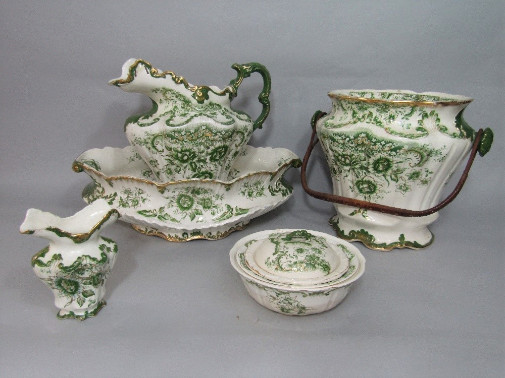 Lot 70 - A collection of late 19th century toilet wares with green printed floral decoration comprising