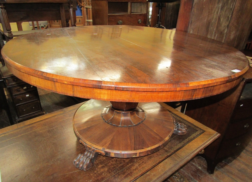 Lot 1469 - A late Regency rosewood breakfast table, the circular top raised on an octagonal vase shaped