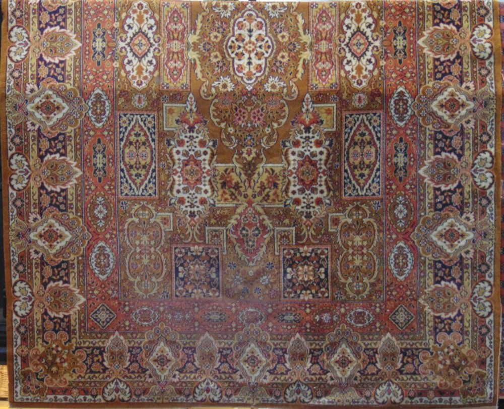 Lot 611 - Eastern machine made carpet decorated with panels of foliage upon a mustard ground, 300 x 200 cm;