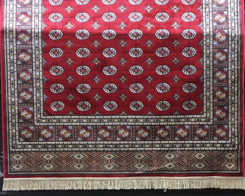 Lot 630 - Kashmir Bokhara, red ground, 230 x 155cm