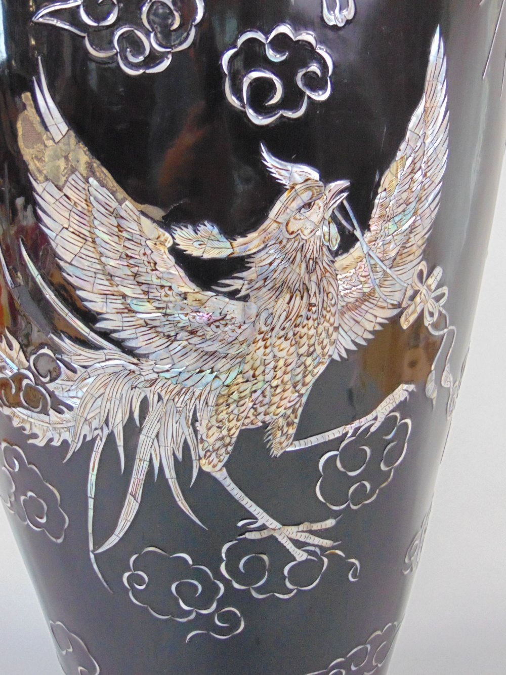 Lot 445 - A very large oriental black lacquer and mother-of-pearl balustrade vase inlaid with dragon phoenix