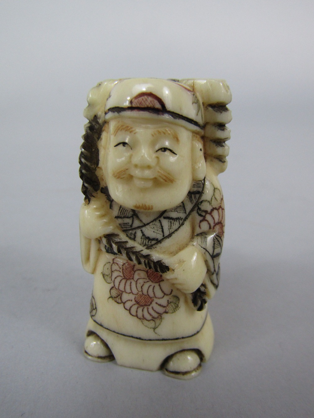Lot 538 - Four late Meiji period carved ivory netsukes of figures of standing gentleman, the largest 6.5cm