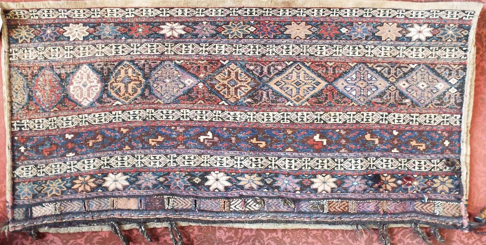 Lot 640 - Kelim rug with various medallions upon a multi-coloured ground dated 1953, 220 x 170 cm together