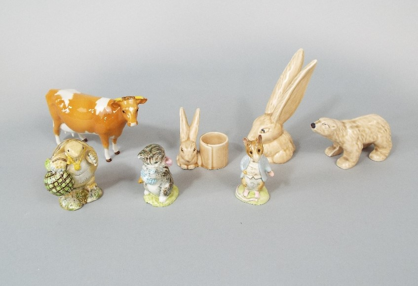 Lot 26 - A collection of Beswick cats comprising a ginger seated example 1867, a grey example 1867, and