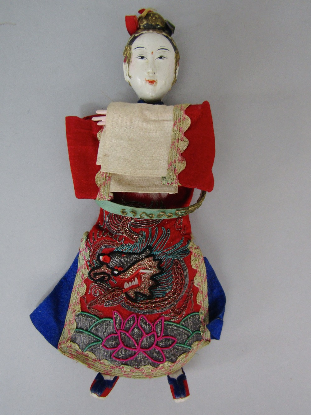 Lot 528 - A pair of antique Chinese male and female opera dolls, together with a pair of seated oriental