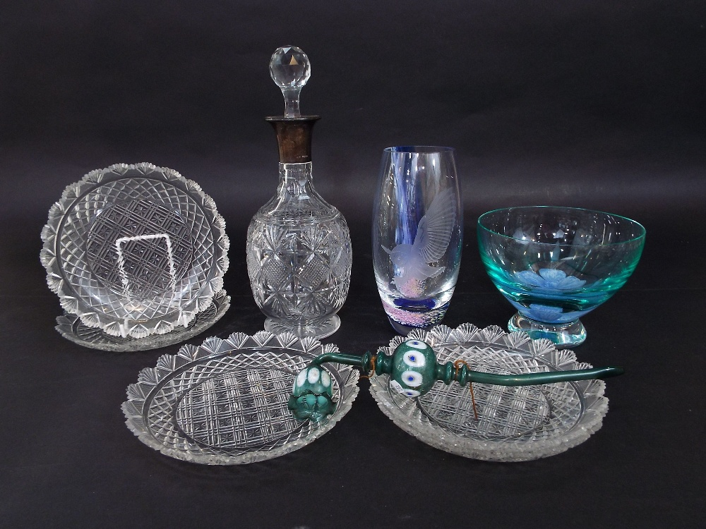 Lot 131 - Silver collared baluster cut glass decanter with prismatic drop stopper, 31 cm high; together with a