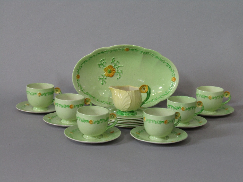 Lot 14 - A collection of Carltonware Buttercup pattern teawares with moulded floral handles comprising oval