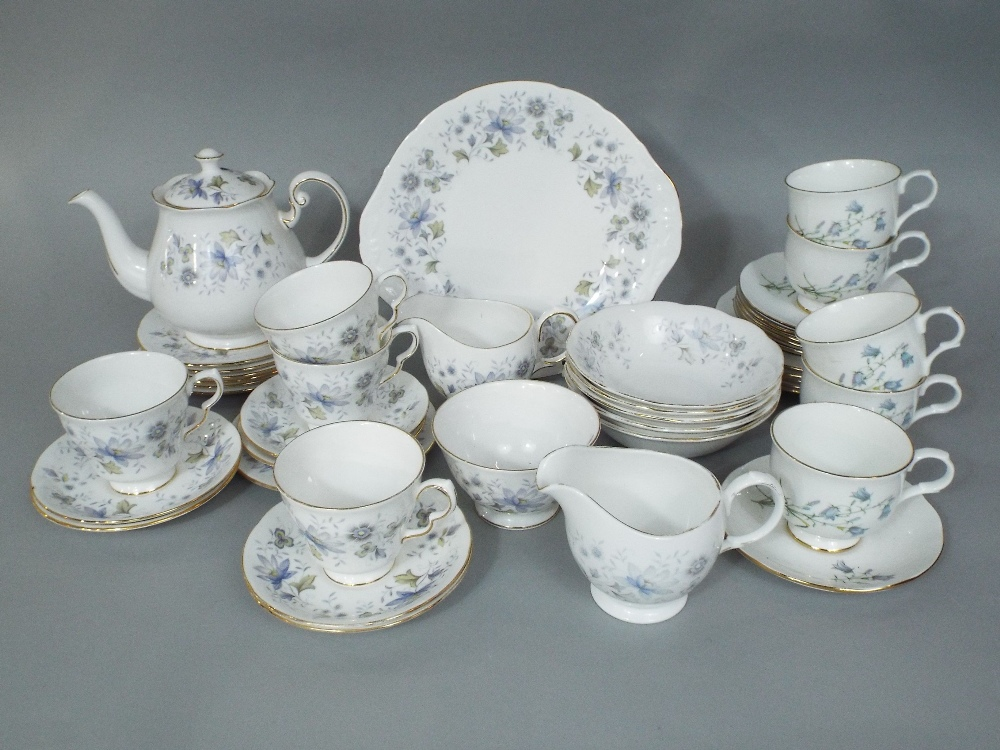 Lot 109 - A collection of Colclough Rhapsody in Blue teawares including cake plate, teapot, two milk jugs,