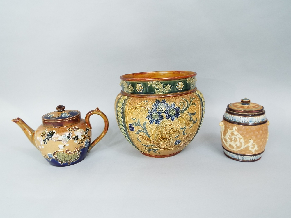 Lot 72 - A collection of Doulton ceramics including a jardiniere with stylised floral and foliate detail,