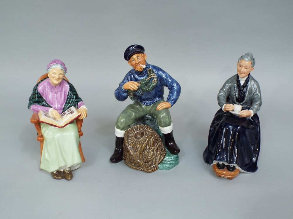 Lot 73 - A collection of eight Royal Doulton figures including the Tinsmith HN2146, The Wig Maker of