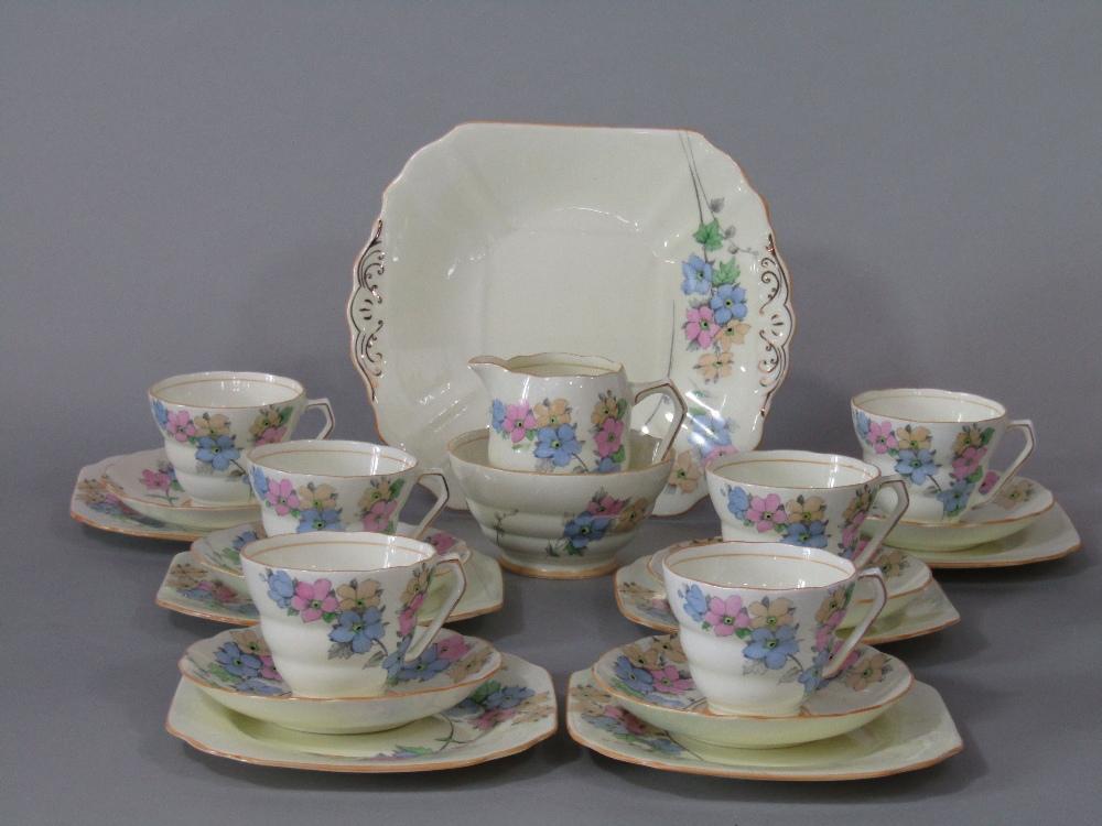 Lot 17 - A Fenton Art Deco tea service with floral detail comprising milk jug, sugar bowl, cake plate, six