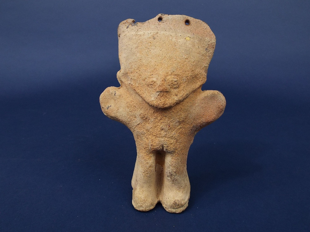 Lot 607 - An early South American terracotta figure of a character, arms outstretched, 17 cm