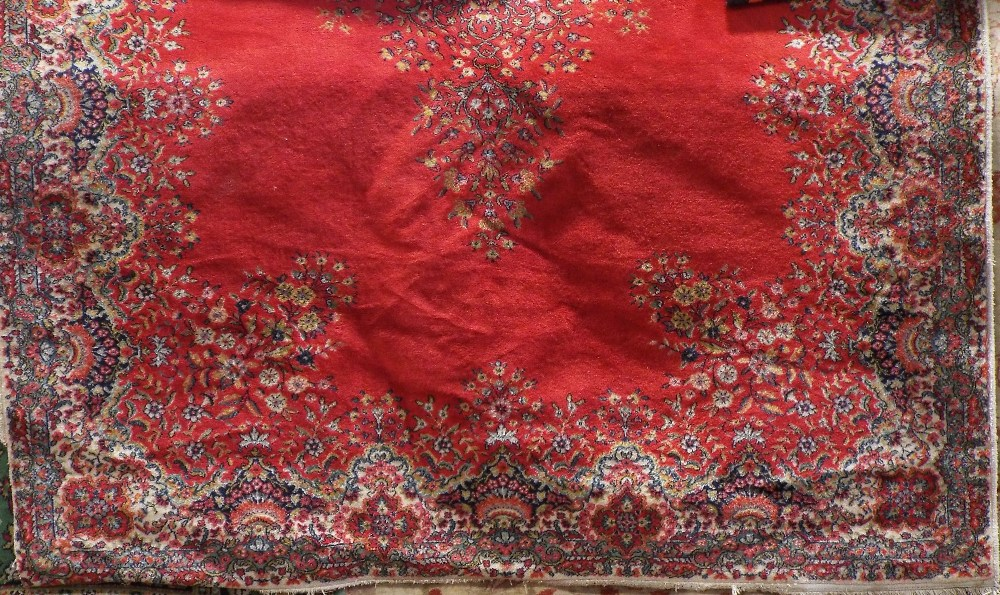Lot 1436 - Axminster type carpet decorated with a central floral medallion upon a red ground, 280 x 200 cm