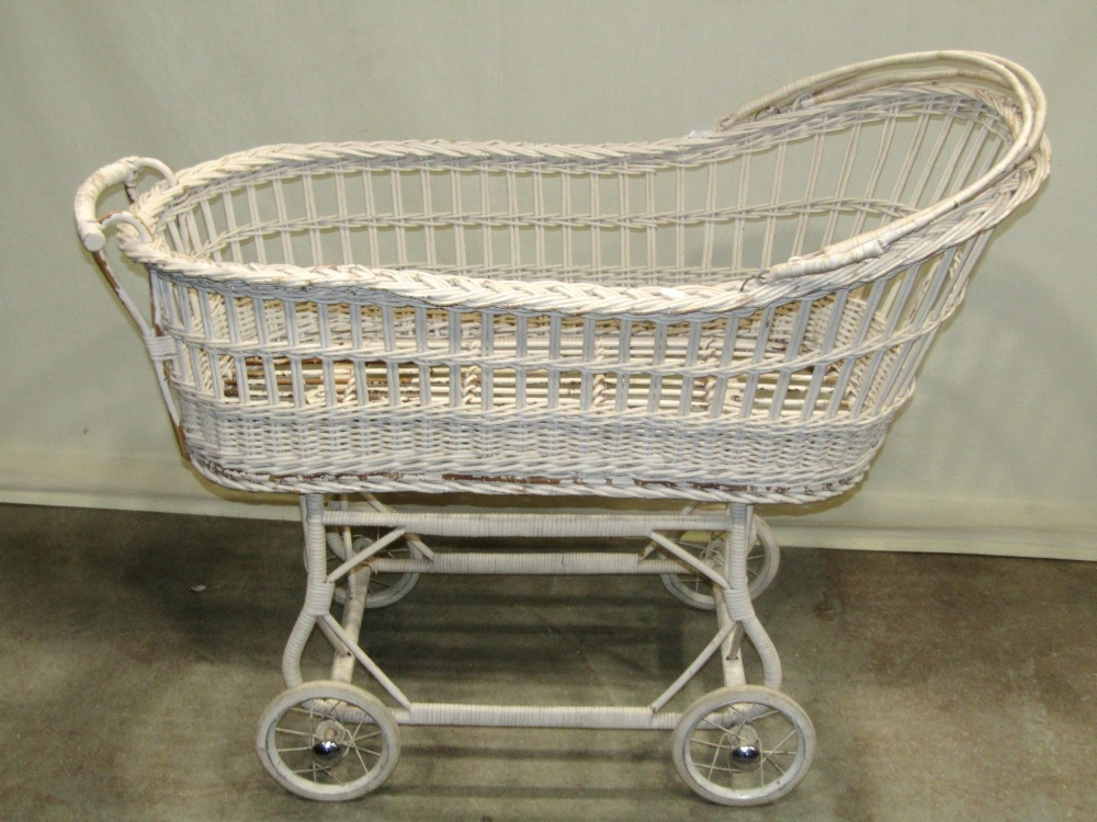 Lot 1298 - A wicker pram with painted finish and wire spoke wheels