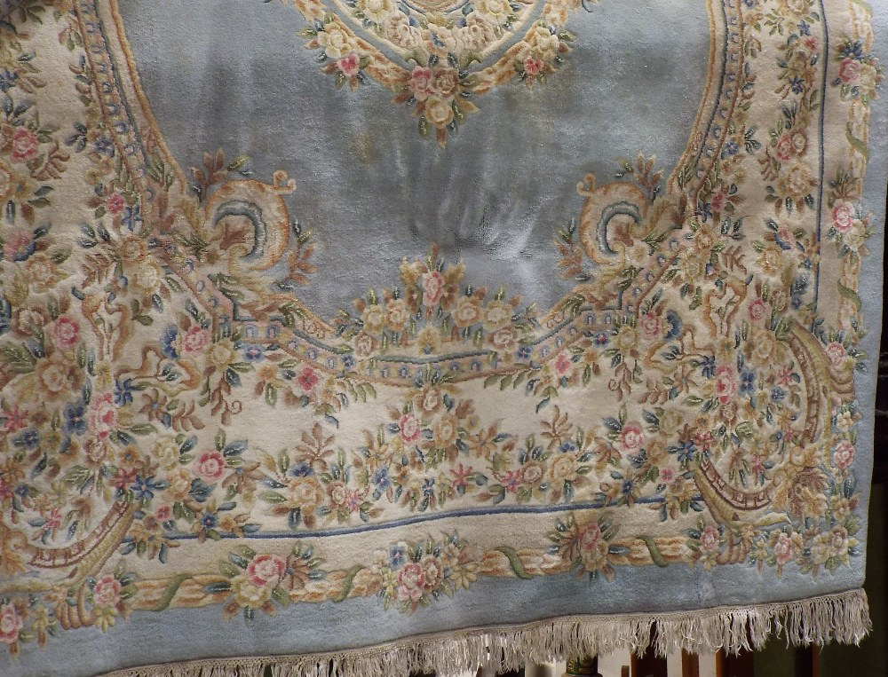 Lot 1425 - A Chinese type wall country house carpet with typical pastel shades and floral bouquets upon a