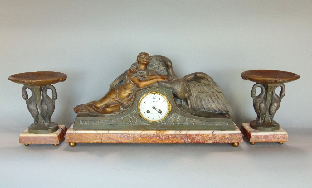 Lot 779 - An art deco clock garniture Leda & Swan garniture with an eight day striking movement, raised on a