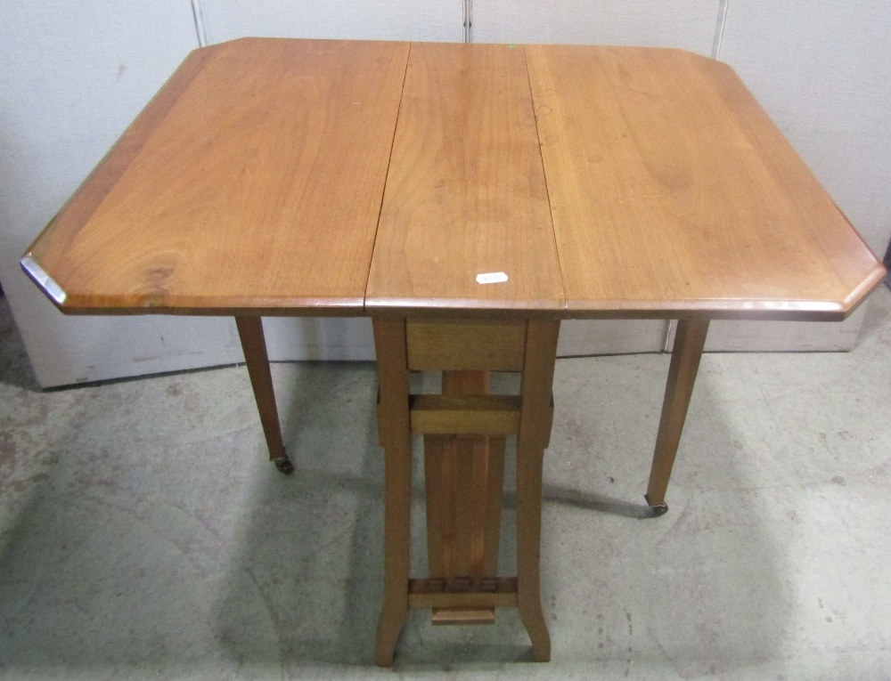 Lot 1402 - An Edwardian stripped oak arts and crafts style drop leaf occasional table, raised on square cut
