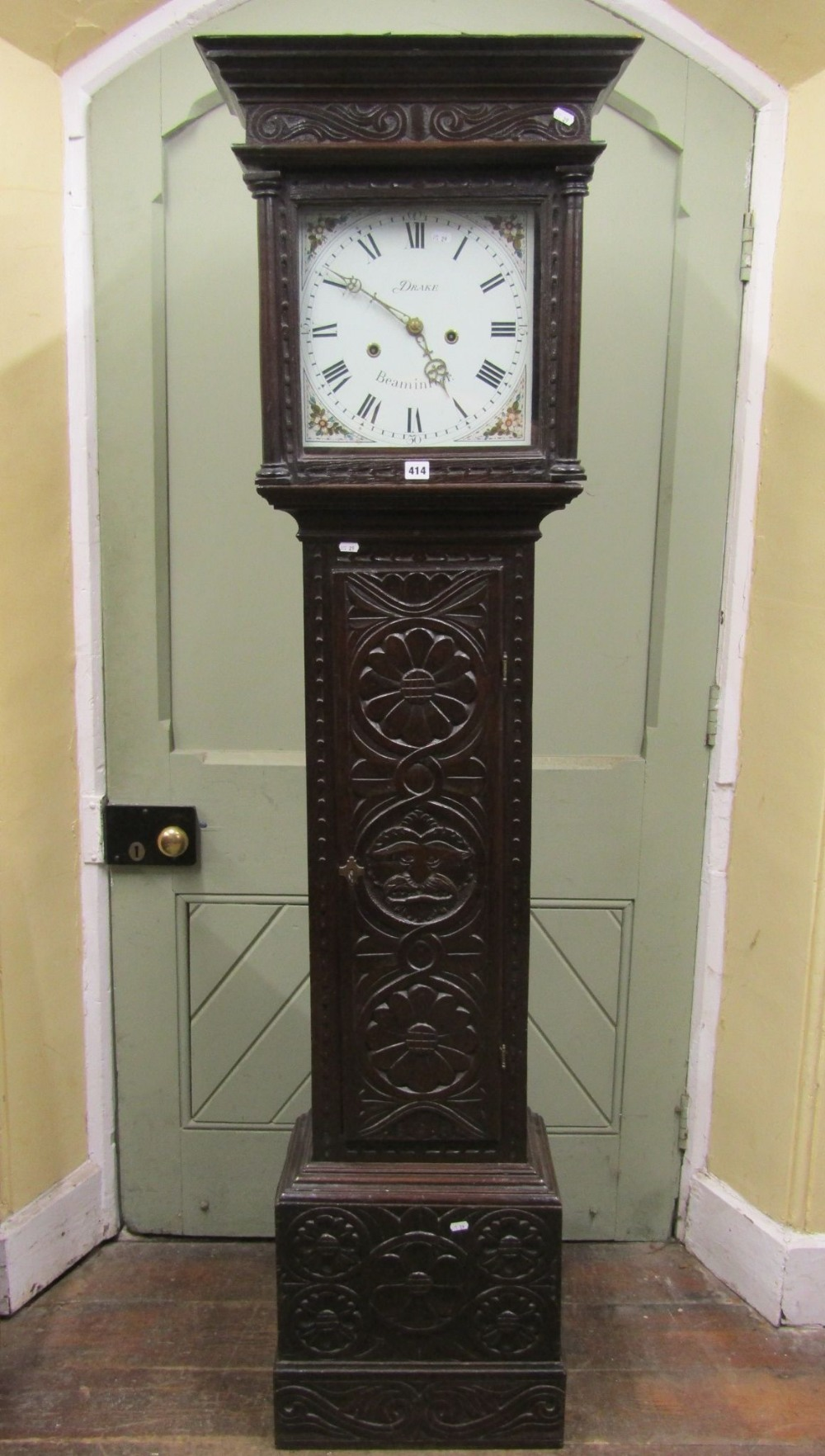 Lot 1451 - An early 19th century longcase ting tang clock, carved throughout with repeating geometric and other