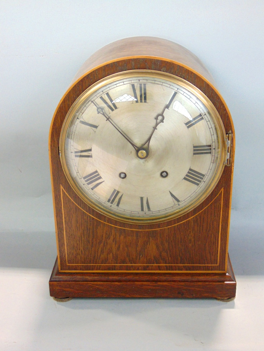 Lot 573 - Oak cased dome top two train mantel clock, silvered dial engraved with Roman numerals, striking on a