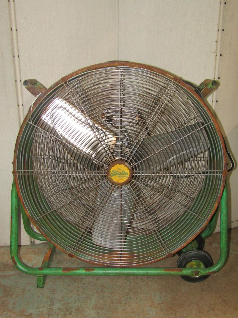 Lot 1172 - An industrial portable electric fan with drum shaped case, tubular frame and painted finish, with