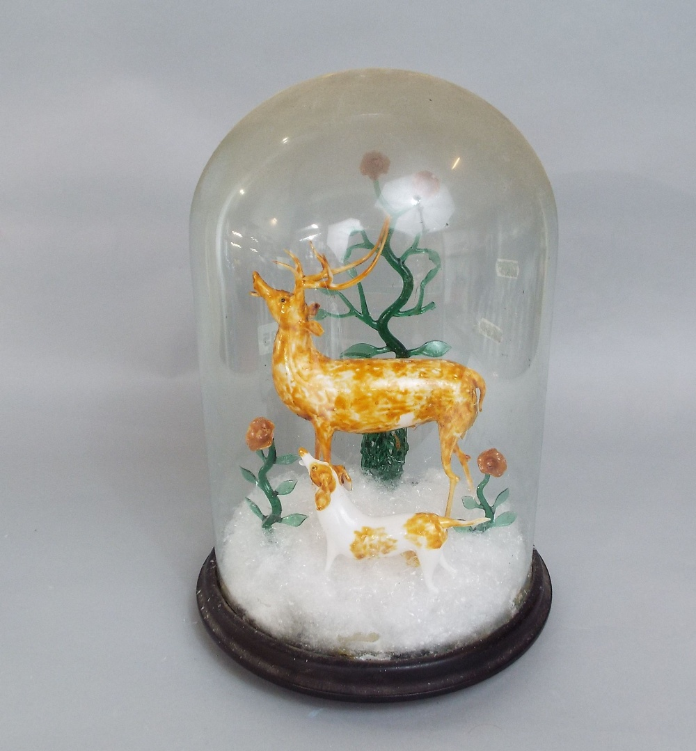 Lot 323 - An interesting Venetian glass diorama comprising a stag and dog in a winter landscape under a