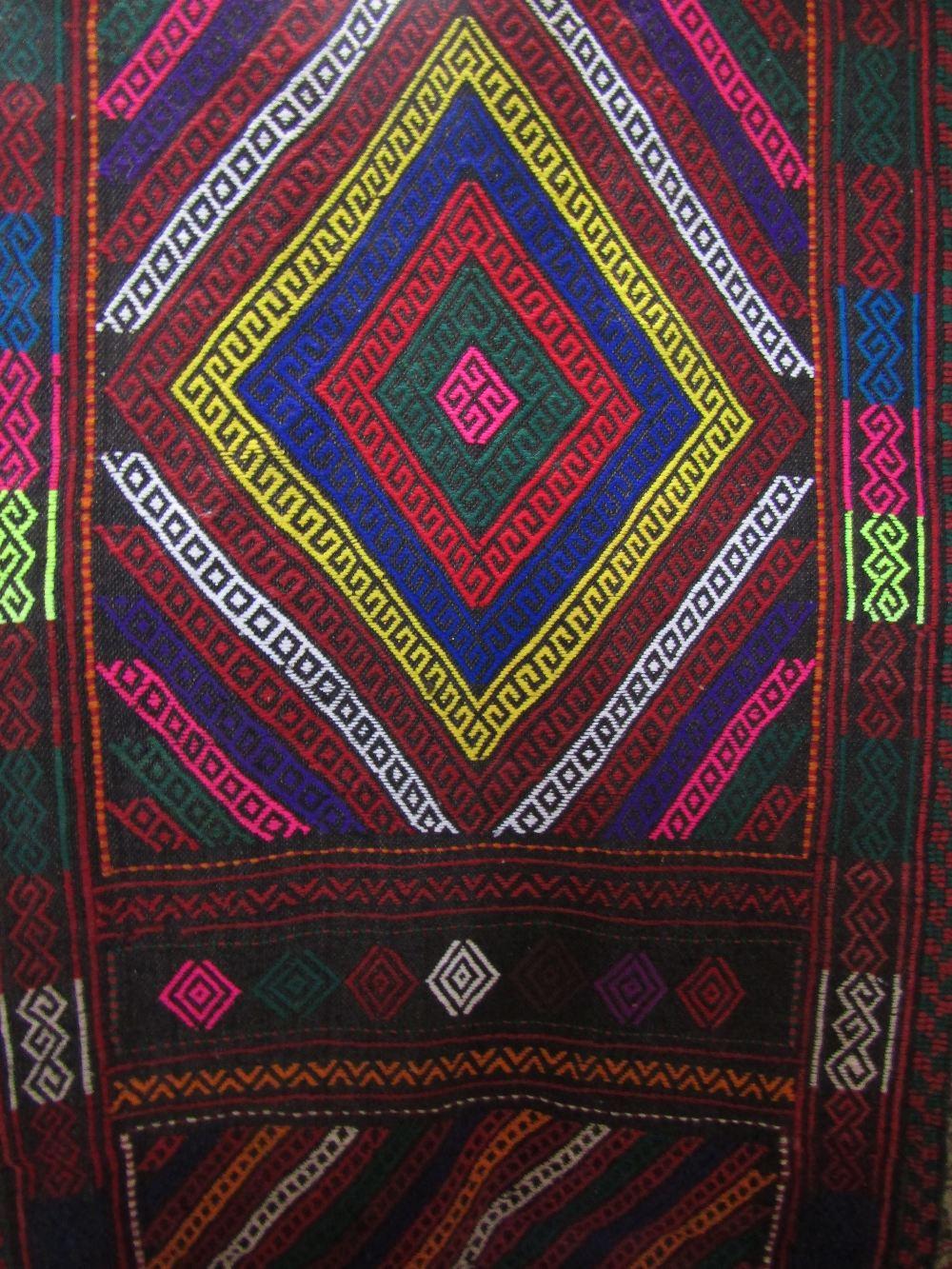 Lot 1423 - Gazak rug with geometric decoration upon a navy blue ground, 120 x 115cm