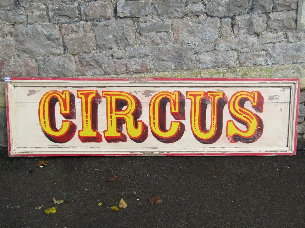 """Lot 1045 - A hand painted wooden sign """"circus"""", with moulded rectangular frame and distressed paint work, 175"""
