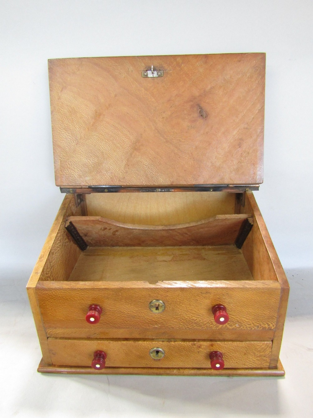 Lot 727 - A plain wood writing slope over two frieze drawers together with a set of cast brass postal scales