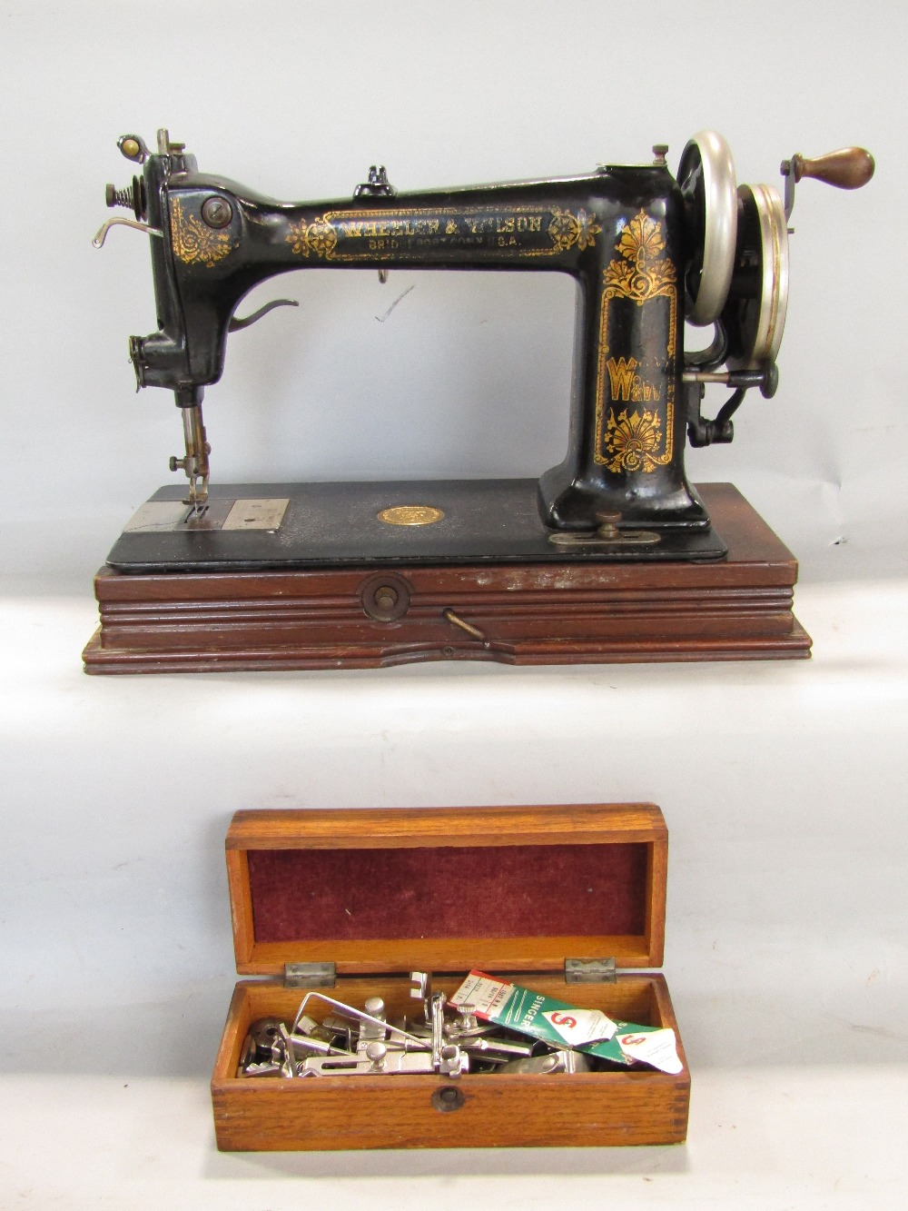 Lot 767 - A sewing machine by Wheeler Wilson of Bridgeport Connecticut circa 1892 number 2749985 together with