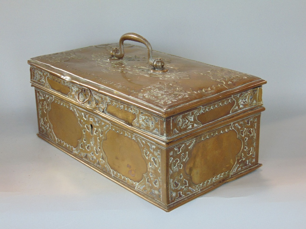 Lot 729 - Interesting eastern brass casket/money box with applied brass strap work decoration, 28cm wide