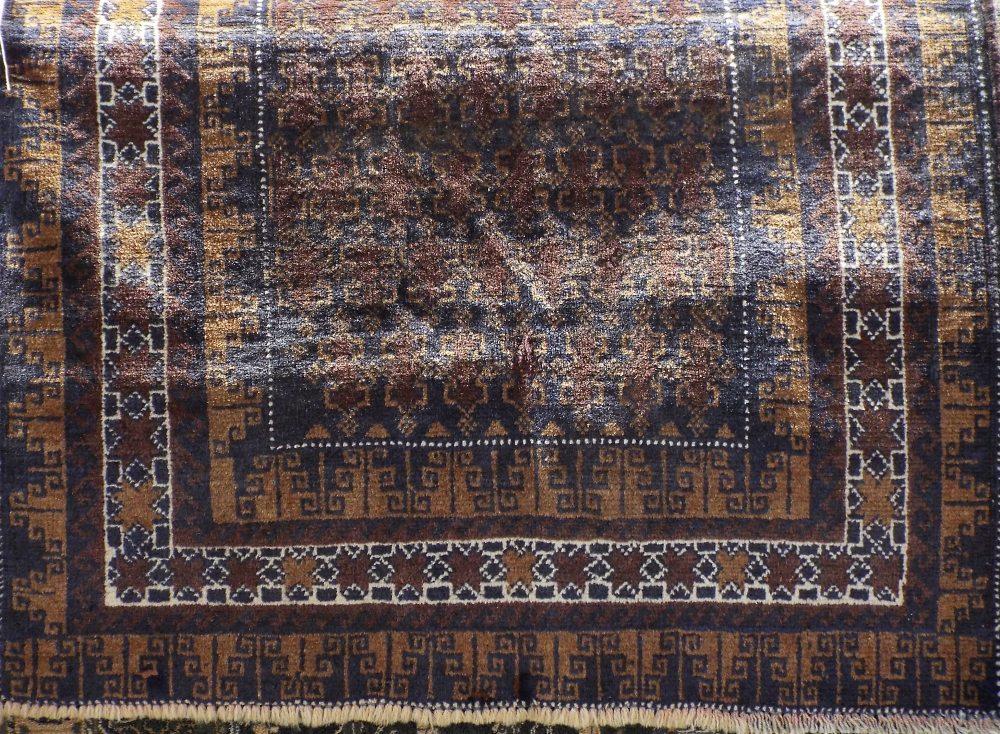 Lot 1448 - Old Baluchi rug, 135 x 89cm