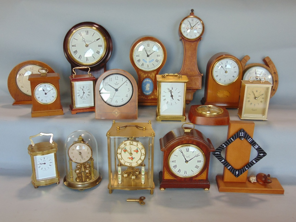 Lot 577 - A box containing a collection of mainly electric clocks by Knight & Gibbins, and Comitti and others