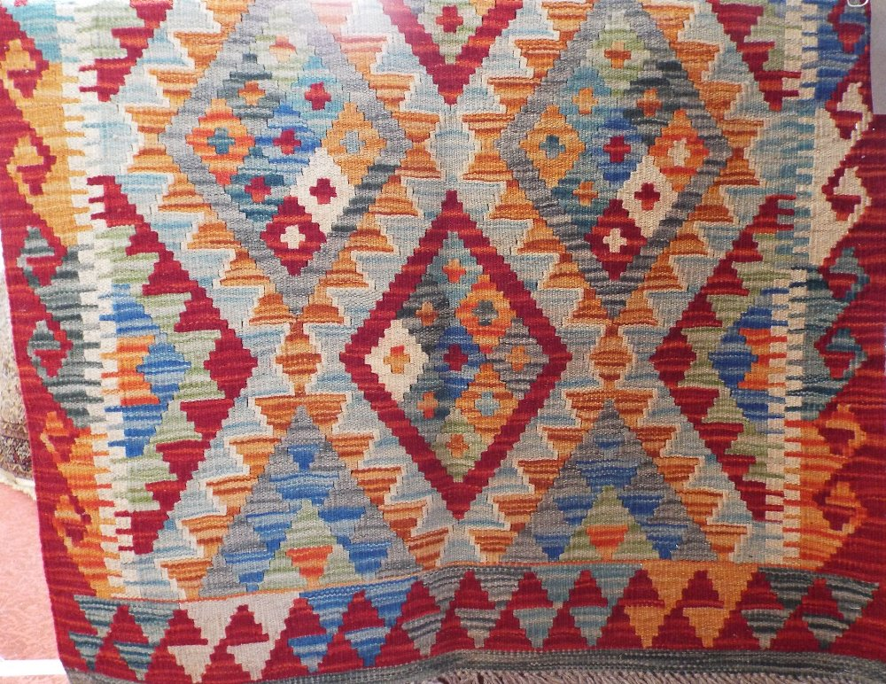 Lot 1449 - Vegetable dye wool Choli Kelim runner, 125 x 85cm