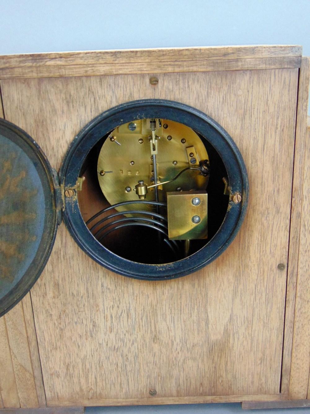 Lot 574 - Art Deco walnut cased twin train mantels clock, with enamel chapter ring, arabic numerals,