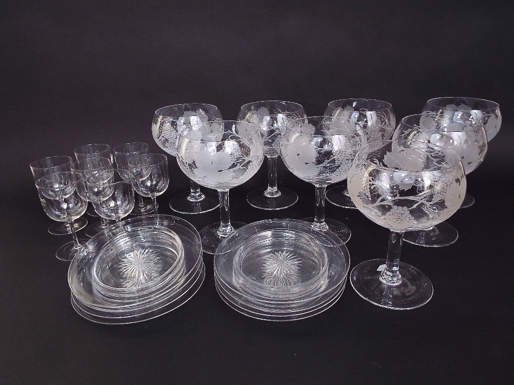 Lot 325 - A set of eight large drinking glasses with etched fruiting vine decoration, together with a