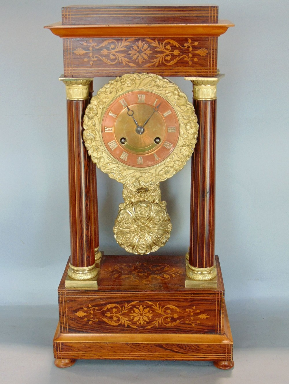 Lot 581 - Good portico rosewood and boxwood inlaid mantel clock, the twin train brass dial with copper chapter