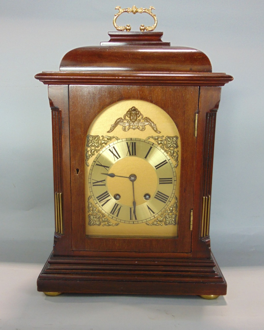 Lot 572 - Mahogany cased twin train bracket type clock, striking on a gong, engraved brass chapter ring,
