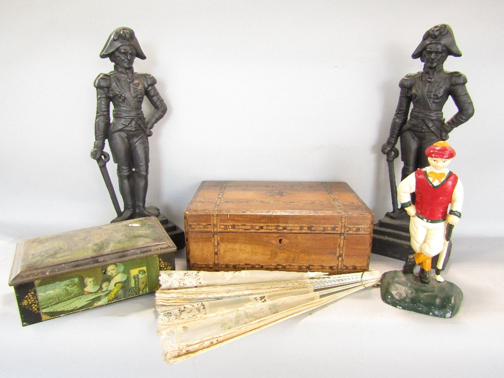 Lot 701 - A mixed collection - a pair of cast iron military door stops, a Victorian walnut and straw work