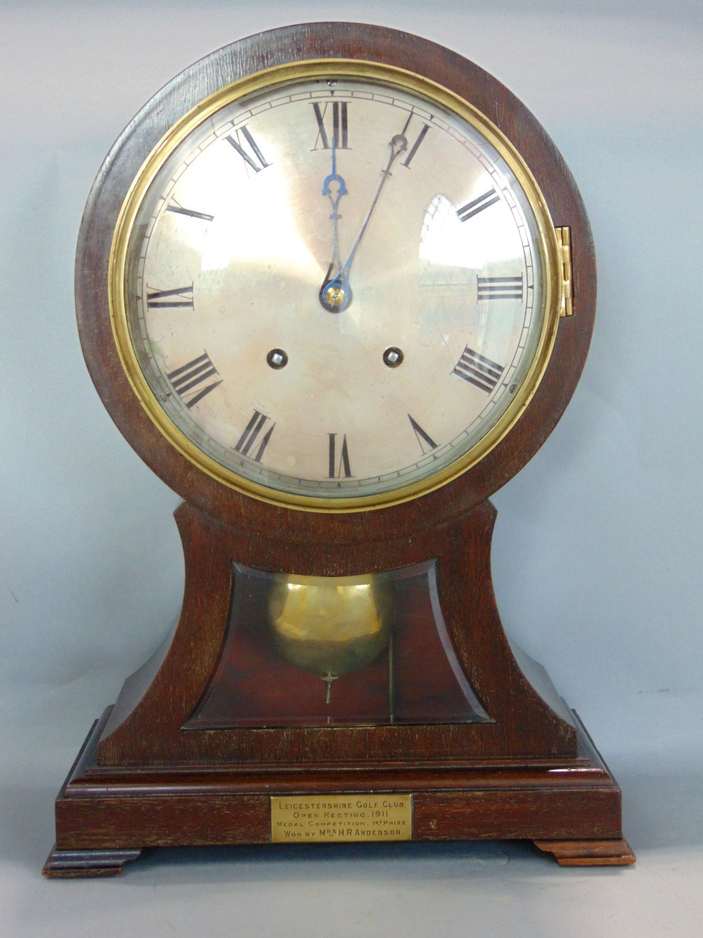 Lot 575 - Early 20th century two train mahogany balloon head mantel clock, the silver dial with engraved Roman