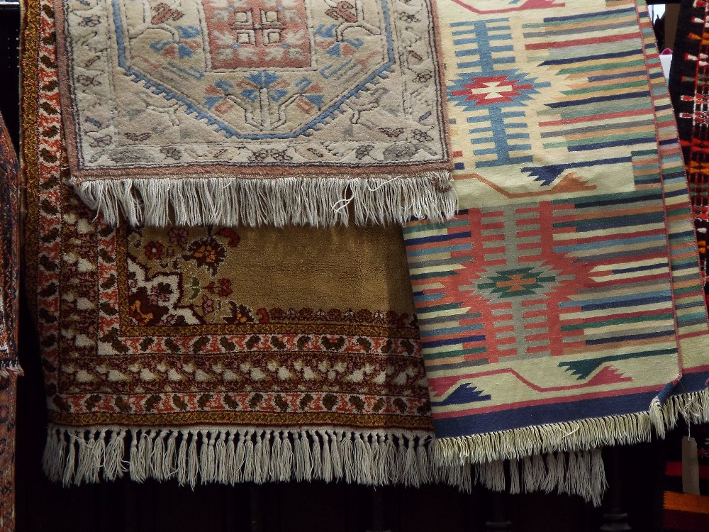Lot 1424 - Full pile Eastern rug with central medallion upon a fawn ground, 200 x 130 cm; together with a