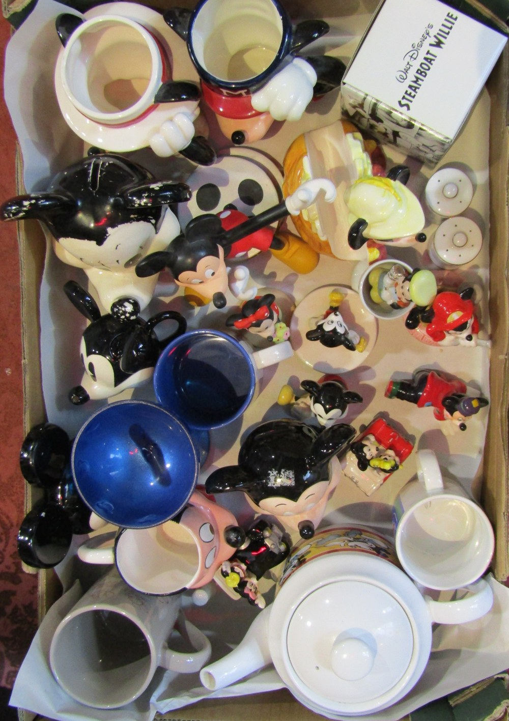 Lot 304 - A collection of Disney related ceramics including a novelty teapot in the form of Mickey's head by