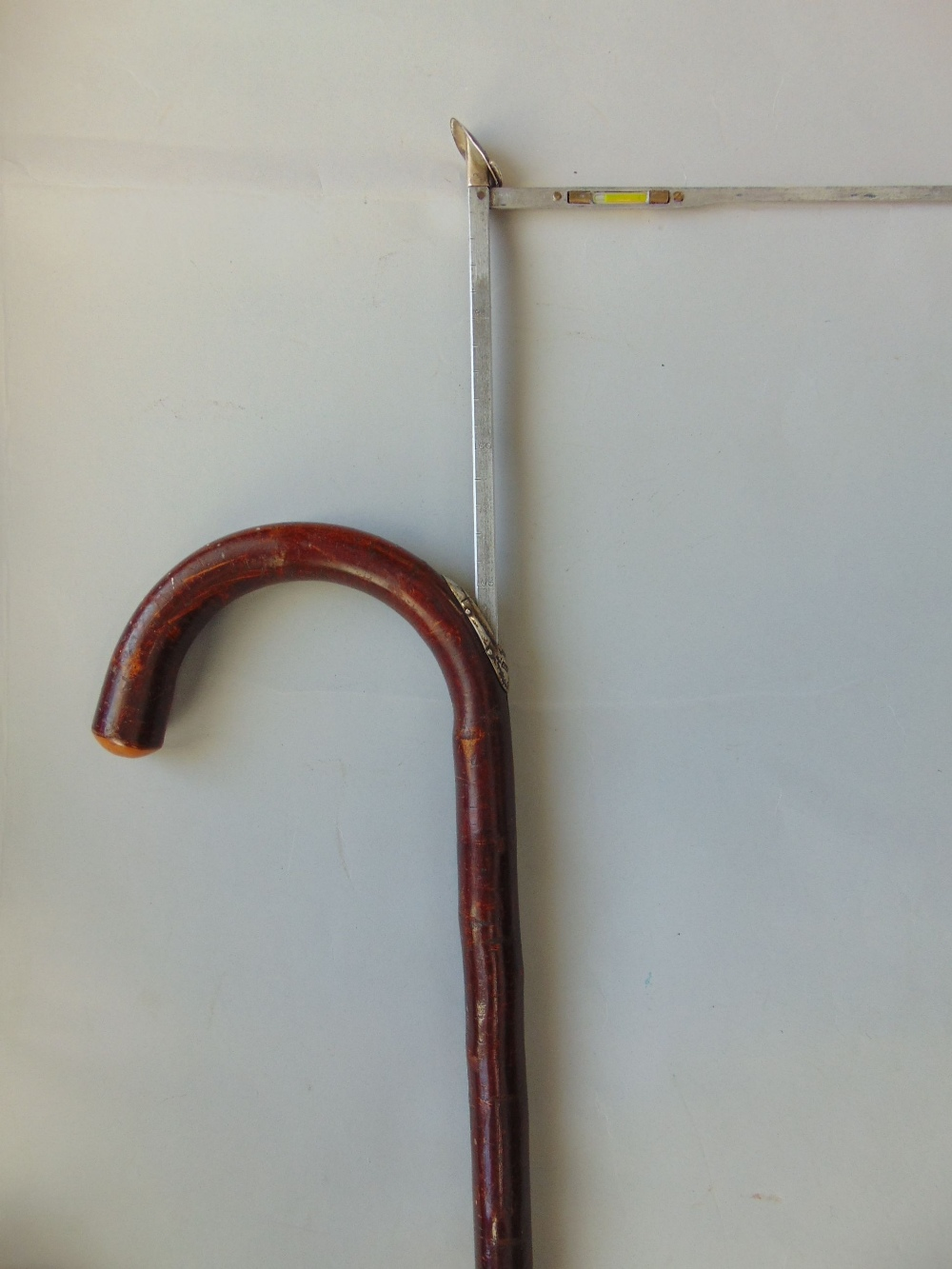 Lot 681 - Silver applied horse measuring stick, hazel thumb stick, a further stick with polished stags horn