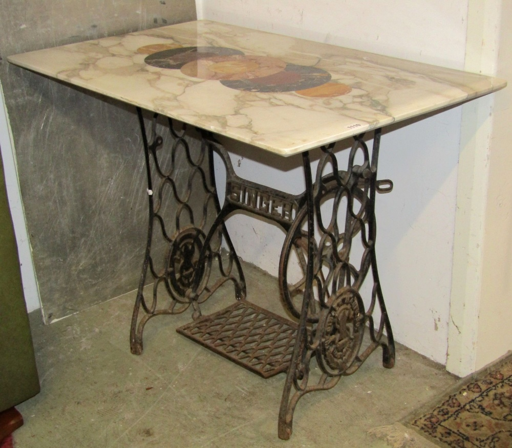 Lot 1110 - A vintage Singer cast iron treadle sewing machine base, with associated rectangular carrera marble