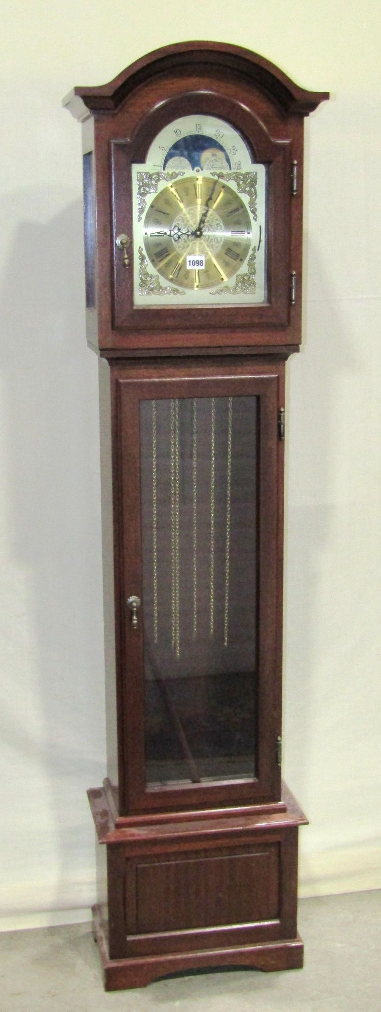 Lot 1098 - A contemporary reproduction small longcase or grandmother clock with arched hood and dial with