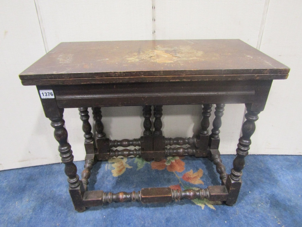 Lot 1376 - An Old English style oak and walnut foldover top occasional table with double gate action, raised on