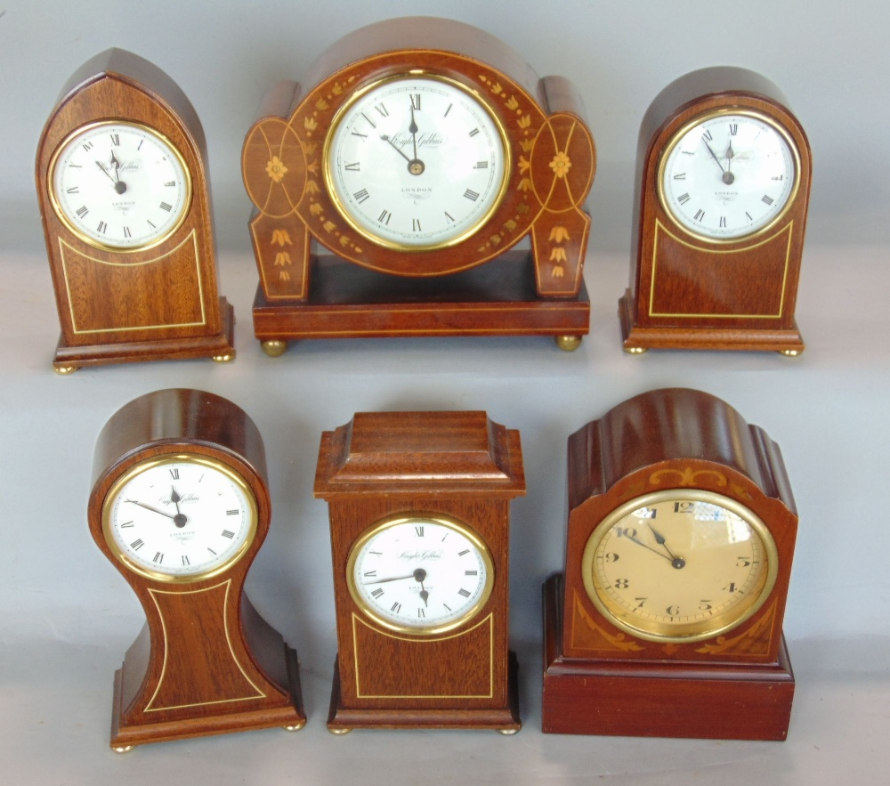 Lot 586 - Five miniature mahogany and boxwood inlaid quartz clocks by Knight & Gibbins, together with one