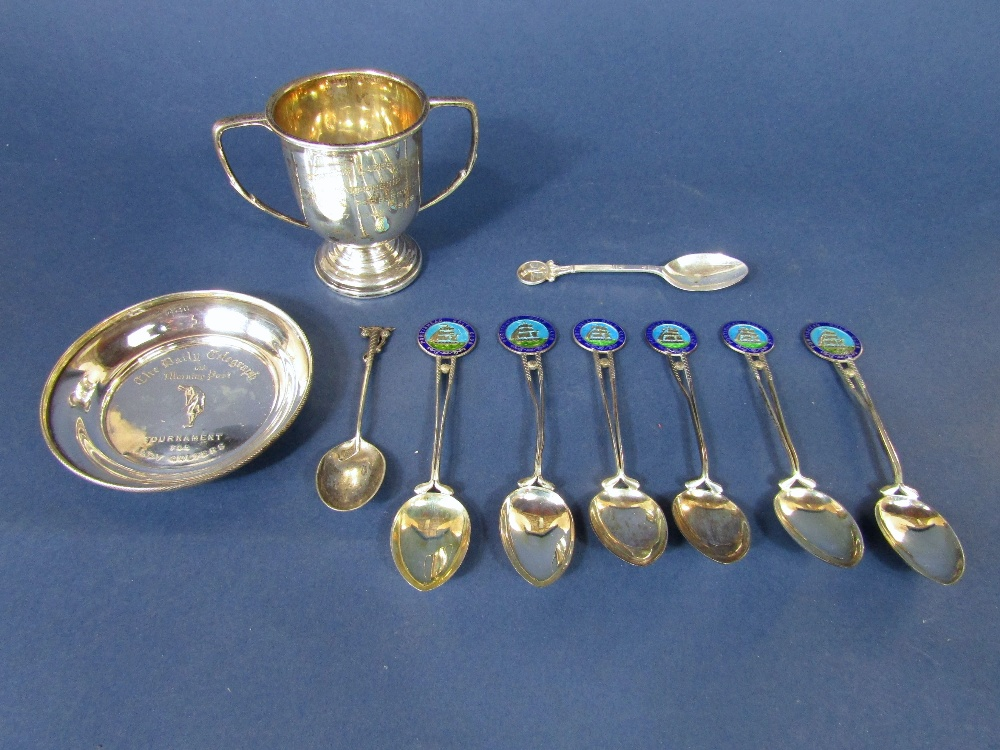 Lot 422 - A mixed silver golfing lot to include a collection of enamel crested spoons, Daily Telegraph
