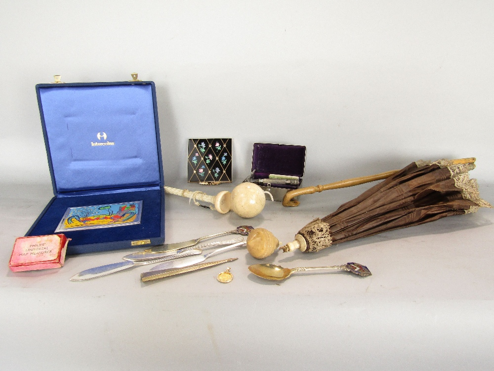 Lot 743 - A Victorian parasol with folding framework, a cup and ball game, 1950s compact, 925 silver panel
