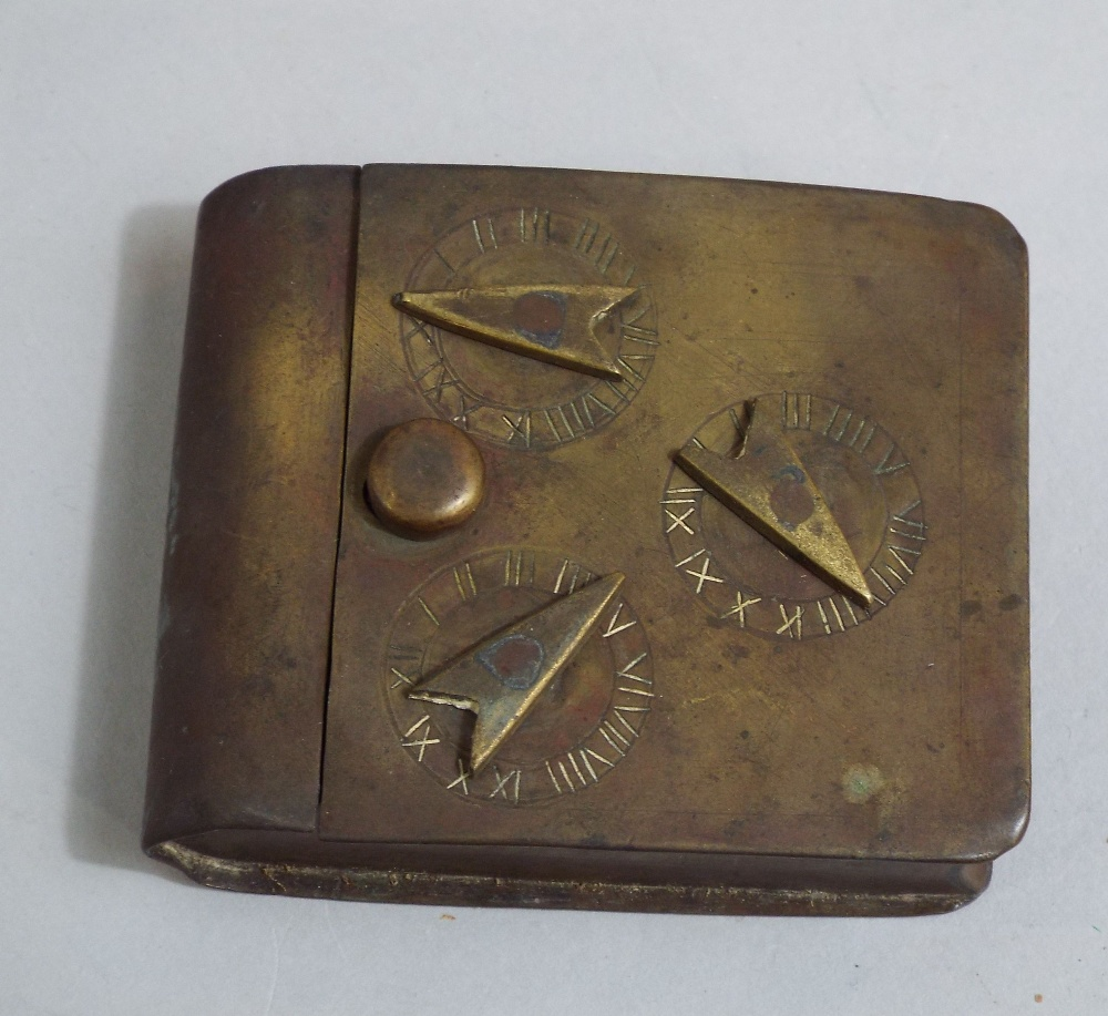 Lot 608 - Unusual 19th century brass pocket snuff box of book shape with three dial locking mechanism
